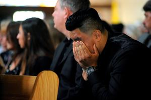 Friends and family gather for a service for Olivia Burke, 21, and Ashley Donohoe, 22, at St. Joseph Catholic Church in Cotati, Calif., Saturday, June 20, 2015.  The two woman were among the several people killed on Tuesday when a balcony snapped off the fifth floor of a Berkeley apartment building during a birthday party. (AP Photo/Michael Short)