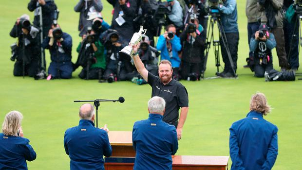 Republic Of Ireland's Shane Lowry celebrate winning the Claret Jug during day four of The Open Championship 2019 at Royal Portrush Golf Club. PRESS ASSOCIATION Photo. Picture date: Sunday July 21, 2019. See PA story GOLF Open. Photo credit should read: Niall Carson/PA Wire. RESTRICTIONS: Editorial use only. No commercial use. Still image use only. The Open Championship logo and clear link to The Open website (TheOpen.com) to be included on website publishing.
