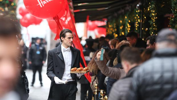 Harrods butlers entertain shoppers as they queue outside the store (Matt Alexander/PA)