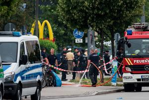 MUNICH, GERMANY - JULY 23: Police and fire services clean the area the shooting occured outside the OEZ shopping center, the day after a shooting spree left nine victims dead on July 23, 2016 in Munich, Germany. According to police an 18-year-old German man of Iranian descent shot nine people dead and wounded at least 16 before he shot himself in a nearby park. For hours during the spree and the following manhunt the city lay paralyzed as police ordered people to stay off the streets. Original reports of up to three attackers seem to have been unfounded. The shooter's motive is so far unclear. (Photo by Joerg Koch/Getty Images)