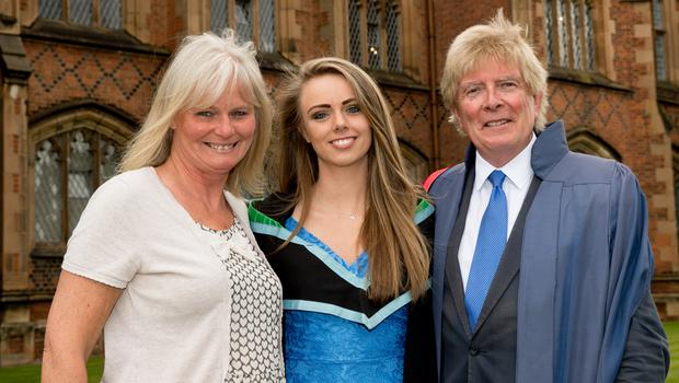 Kate Donnan celebrated graduating with a First Class Honours degree, from the School of Medicine, Dentistry and Biomedical Sciences at Queen's University Belfast. She is pictured with her parents, Katherine and Professor Hastings Donnan.