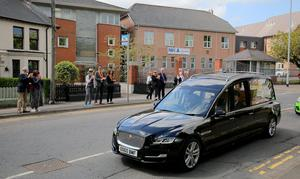 The funeral of BJ Hogg passes his home at Westbourne Terrace in Lisburn on May 4th 2020 (Photo by Kevin Scott for Belfast Telegraph)