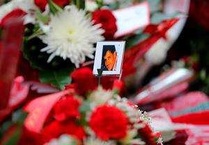 LIVERPOOL, ENGLAND - APRIL 15:  Tributes are left outside Anfield stadium before a memorial service to mark the 27th anniversary of the Hillsborough disaster, on April 15, 2016 in Liverpool, England. Thousands of fans, friends and relatives took part in the final Anfield memorial service for the 96 victims of the Hillsborough disaster. Earlier this year relatives of the victims agreed that this year's service would be the last. Bells across the City of Liverpool rung during a one minute silence in memory of the 96 Liverpool supporters who lost their lives during a crush at an FA Cup semi-final match against Nottingham Forest at the Hillsborough football ground in Sheffield, South Yorkshire in 1989.  (Photo by Christopher Furlong/Getty Images)