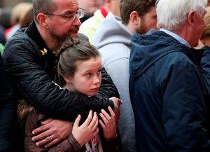 LIVERPOOL, ENGLAND - APRIL 15:  People arrive for a memorial service to mark the 27th anniversary of the Hillsborough disaster, at Anfield stadium on April 15, 2016 in Liverpool, England. Thousands of fans, friends and relatives will take part in the final Anfield memorial service for the 96 victims of the Hillsborough disaster. Earlier this year relatives of the victims agreed that this year's service would be the last. Bells across the City of Liverpool will ring out during a one minute silence in memory of the 96 Liverpool supporters who lost their lives during a crush at an FA Cup semi-final match against Nottingham Forest at the Hillsborough football ground in Sheffield, South Yorkshire in 1989.  (Photo by Christopher Furlong/Getty Images)