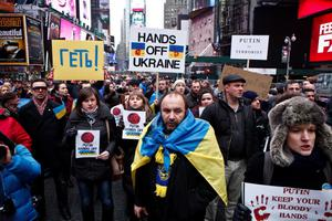 NEW YORK, NY - MARCH 2: People take part during a protest in Times Square against Russian military intervention in the Crimea region of Ukraine, on March 2, 2014, in New York City. Interim Ukrainian Prime Minister Arseniy Yatsenyuk urged Russian President Vladimir Putin to pull back troops that spread out across the Crimean Peninsula today, one day after Russia's parliament approved to use military force in Ukraine. (Photo by Kena Betancur/Getty Images)