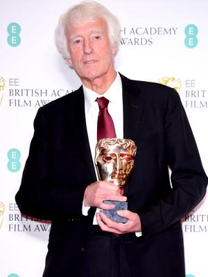 Roger Deakins with his award for cinematography for 1917 (Ian West/PA)