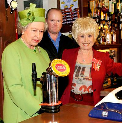 File photo dated 28/11/01 of Queen Elizabeth II (left) in the Queen Vic pub during a visit to Elstree Studios where EastEnders is filmed. She was accompanied by long standing cast member Barbara Windsor (Peggy Mitchell) and her on-screen son Steve McFadden (Phil Mitchell) as the Queen turns 90 on the April 21st. PRESS ASSOCIATION Photo. Issue date: Sunday April 3, 2016. See PA story ROYAL Birthday. Photo credit should read: Fiona Hanson/PA Wire