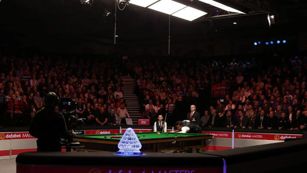 Ronnie O'Sullivan plays his shot watched by Mark Selby (left) during the 2014 Dafabet Masters at Alexandra Palace, London. PRESS ASSOCIATION Photo. Picture date: Sunday January 19, 2014. See PA story SNOOKER Masters. Photo credit should read: John Walton/PA Wire