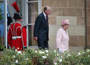 Queen Elizabeth II and Prince Philip, Duke of Edinburgh attend a garden party in the grounds of Hillsborough Castle on June 24, 2014 near Belfast, Northern Ireland. The Royal party are visiting Northern Ireland for three days.  (Photo by Peter Macdiarmid/Getty Images)