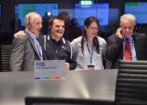 The picture released by the European Space Agency ESA on Wednesday, Nov. 12, 2014, showing scientists react in the main control room at the European Space Agency after the first unmanned spacecraft Philae landed on a comet called 67P/Churyumov-Gerasimenko, Darmstadt, Germany.