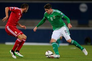 Northern Ireland's Kyle Lafferty (right) and Hungary's Attila Fiola during the UEFA European Championship Qualifying match at Windsor Park, Belfast. Photo: Liam McBurney/PA Wire