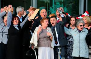 WARRINGTON, ENGLAND - APRIL 26:  Relatives of the Hillsborough sing 'You'll never walk alone' as they depart Birchwood Park after hearing the conclusions of the Hillsborough inquest on April 26, 2016 in Warrington, England. The fresh inquests into the 1989 Hillsborough disaster, in which 96 football supporters were crushed to death, concluded on April 26, 2016 with a verdict of unlawful killing, after the initial verdicts were quashed. Relatives of Liverpool supporters who died in Britain's worst sporting disaster gathered in the purpose-built court to hear the jury's verdict in Warrington after a 25 year fight to overturn the accidental death verdicts handed down at the initial 1991 inquiry.  (Photo by Dave Thompson/Getty Images)