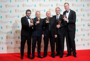 LONDON, ENGLAND - FEBRUARY 16: Glenn Freemantle, Skip Lievsay, Christopher Benstead, Niv Adiri and Chris Munro, winners of the Best Sound award, pose in the winners room at the EE British Academy Film Awards 2014 at The Royal Opera House on February 16, 2014 in London, England.  (Photo by Anthony Harvey/Getty Images)
