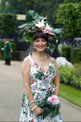 A female racegoer enjoys the atmosphere during Ladies' Day of the Royal Ascot meeting at Ascot Racecourse, Berkshire. PRESS ASSOCIATION Photo. Picture date: Thursday June 20, 2013. See PA story RACING Ascot. Photo credit should read: Steve Parsons/PA Wire