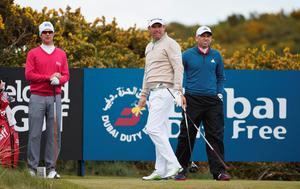NEWCASTLE, NORTHERN IRELAND - MAY 28:  Padraig Harrington of Ireland looks down the 18th holewith Mikko Ilonen and Sergio Garcia  during the First Round of the Dubai Duty Free Irish Open Hosted by the Rory Foundation at Royal County Down Golf Club on May 28, 2015 in Newcastle, Northern Ireland.  (Photo by Ross Kinnaird/Getty Images)