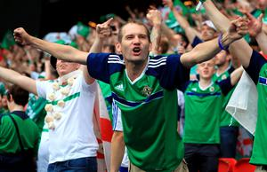 Northern Ireland fans continue to celebrate despite defeat well after the final whistle is blown, during the UEFA Euro 2016, Group C match at the Parc Des Princes, Paris. PRESS ASSOCIATION Photo. Picture date: Tuesday June 21, 2016. See PA story SOCCER N Ireland. Photo credit should read: Mike Egerton/PA Wire. RESTRICTIONS: Use subject to restrictions. Editorial use only. Book and magazine sales permitted providing not solely devoted to any one team/player/match. No commercial use. Call +44 (0)1158 447447 for further information.
