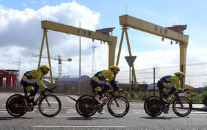 Memebers of the Tinkoff-Saxo team pass the Harland and Wolff cranes Samson and Goliath during a training session prior to stage one of the 2014 Giro D'Italia