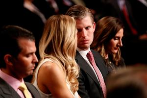 LAS VEGAS, NV - OCTOBER 19: Eric Trump speaks with his wife Lara Yunaska before the start of the third U.S. presidential debate at the Thomas & Mack Center on October 19, 2016 in Las Vegas, Nevada. Tonight is the final debate ahead of Election Day on November 8.  (Photo by Win McNamee/Getty Images)