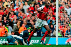 Painful blow: Patrick Vieira leaves Roy Carroll angry and hurt after netting winning penalty in 2005