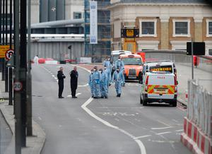 Police forensic officers on London Bridge following last night's terrorist incident. PRESS ASSOCIATION Photo. Picture date: Sunday June 4, 2017. See PA story POLICE Bridge. Photo credit should read: Andrew Matthews/PA Wire