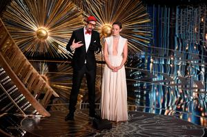 Actor Sacha Baron Cohen (L) and Olivia Wilde arive on stage at the 88th Oscars on February 28, 2016 in Hollywood, California. AFP PHOTO / MARK RALSTONMARK RALSTON/AFP/Getty Images