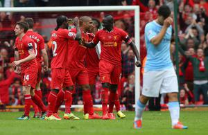 The Liverpool players celebrate at the end of the Barclays Premier League match between Liverpool and Manchester City at Anfield on April 13, 2014 in Liverpool, England.  (Photo by Alex Livesey/Getty Images)