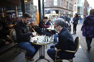 People play drafts on the streets during culture night in Belfast city centre attracted thousands of people.  Picture by Peter Morrison
