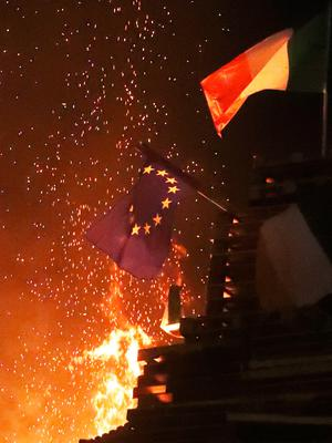An EU flag is burned on an 11th night Bonfire in the Sandy Row area of Belfast.  PRESS ASSOCIATION Photo. Picture date: Thursday July 12, 2018. Hundreds of bonfires were set to be lit at midnight as part of a loyalist tradition to mark the anniversary of the Protestant King William's victory over the Catholic King James at the Battle of the Boyne in 1690. See PA story ULSTER Bonfires. Photo credit should read: Niall Carson/PA Wire