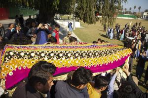 Relatives carry the body of journalist Malala Maiwand (AP)