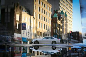Credit - Kevin Scott / Presseye  Editors note this image has been rotated 180 degrees  Belfast, UK - January 03 , Pictured is cars driving past a large puddle in Belfast City Centre January 03, 2016 ( Photo by Kevin Scott / Presseye )