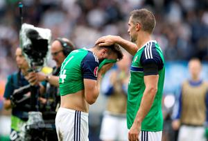 Northern Ireland's Aaron Hughes (right) consoles teammate Stuart Dallas (left) after the UEFA Euro 2016, Group C match at the Parc Des Princes, Paris. PRESS ASSOCIATION Photo. Picture date: Tuesday June 21, 2016. See PA story SOCCER N Ireland. Photo credit should read: Owen Humphreys/PA Wire. RESTRICTIONS: Use subject to restrictions. Editorial use only. Book and magazine sales permitted providing not solely devoted to any one team/player/match. No commercial use. Call +44 (0)1158 447447 for further information.