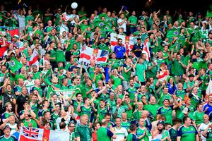 Northern Ireland fans show their continued support in the stands following the UEFA Euro 2016, Group C match at the Parc Des Princes, Paris. PRESS ASSOCIATION Photo. Picture date: Tuesday June 21, 2016. See PA story SOCCER N Ireland. Photo credit should read: Jonathan Brady/PA Wire. RESTRICTIONS: Use subject to restrictions. Editorial use only. Book and magazine sales permitted providing not solely devoted to any one team/player/match. No commercial use. Call +44 (0)1158 447447 for further information.