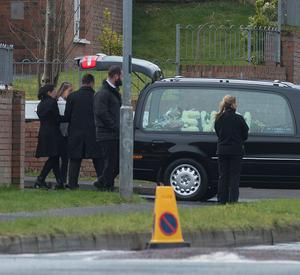 Louise James, in black, places her son Evan in a hearse.   The funerals of Sean McGrotty, 46,  his two young sons Mark 12,  and Evan James, 8,  Ruth Daniels, 57, the mother of Mr McGrottys partner Louise, who was in England at the time and Ms Daniels teenage daughter Jodie-Lee,15, who died when their car slipped into the water from a slipway in Buncrana at the weekend. The only survivor of the tragedy was Mr. McGrottys baby Rioghnach James. Picture Martin McKeown. Inpresspics.com. 24.03.17