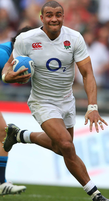Out of reach: Jonathan Joseph runs in for a try