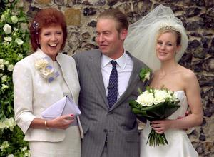 Cilla Black, son Robert Willis and his new wife Fiona after their wedding at St Mary The Virgin Church in Denham, Buckinghamshire in 2001. Matthew Fearn/PA Wire.
