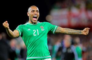 Northern Ireland's Josh Magennis celebrates after winning the UEFA Euro 2016 qualifying Group F football match between Northern Ireland and Greece at Windsor Park in Belfast, Northern Ireland, on October 8, 2015.    AFP PHOTO / PAUL FAITHPAUL FAITH/AFP/Getty Images