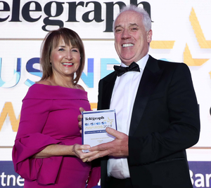 The Excellence in Exporting award is presented to Tony Convery of CDE by Ann McGregor