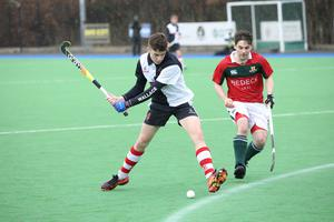 Wallace High School's Max Taylor, left, in action against Friends School's Rory Brown during the Burney Cup Hockey Semi-Final.  Photo by Peter Morrison