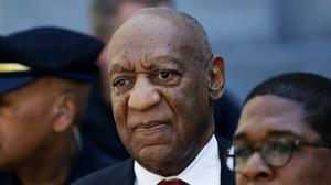 Bill Cosby, centre, leaves the the Montgomery County Courthouse in Norristown, Pennsylvania., after being convicted in 2018 (Matt Slocum/AP)