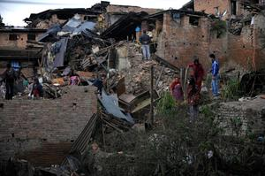 "People search amidst the rubble of collapsed houses in Bhaktapur, on the outskirts of Kathmandu, on April 27, 2015, two days after a 7.8 magnitude earthquake hit Nepal. Nepalis started fleeing their devastated capital on April 27 after an earthquake killed more than 3,800 people and toppled entire streets, as the United Nations prepared a ""massive"" aid operation.  AFP PHOTO / PRAKASH MATHEMAPRAKASH MATHEMA/AFP/Getty Images"