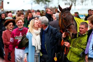 LIVERPOOL, ENGLAND - APRIL 09:  Owner Michael O'Leary kisses his wife Anita Farrell as David Mullins smiles in the Winners' Enclosure after riding Rule The World to victory in the 2016 Crabbie's Grand National at Aintree Racecourse on April 9, 2016 in Liverpool, England.  (Photo by Michael Steele/Getty Images)