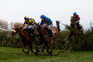 LIVERPOOL, ENGLAND - APRIL 09:  The Last Samuri ridden by David Bass and Vics Canvas ridden by Robert Dunne clear the last fence as eventual winner Rule The World ridden by David Mullins jumps it in third position during the Crabbie's Grand National Steeple Chase at Aintree Racecourse on April 9, 2016 in Liverpool, England.  (Photo by Alex Livesey/Getty Images)