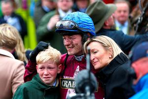 LIVERPOOL, ENGLAND - APRIL 09:  David Mullins poses in the Winners' Enclosure after riding Rule The World to victory in the 2016 Crabbie's Grand National at Aintree Racecourse on April 9, 2016 in Liverpool, England.  (Photo by Michael Steele/Getty Images)