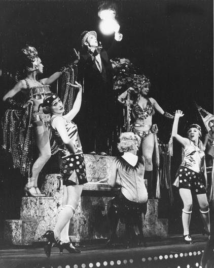 Joel Grey stands on the piano during the Money Song with the ensemble in the original Broadway musical Cabaret at the Broadhurst Theatre in New York (AP)