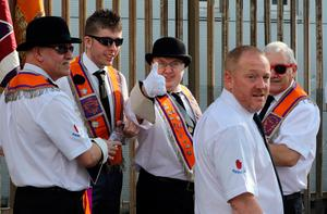 Orangemen are pictured taking part in the annual July 12 parade in Belfast, on July 12, 2017. July 12 is the main marching day in the Orange Order calendar. The parades mark the Protestant commemoration of the 327th anniversary of King William III's victory at the Battle of the Boyne in 1690. / AFP PHOTO / Paul FAITHPAUL FAITH/AFP/Getty Images