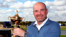 Main man: Thomas Bjorn lifts the Ryder Cup in Paris