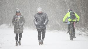 People walking through snow fall in Clowes Wood, Kent (Yui Mok/PA)