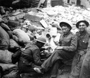 WORLD WAR II: BELFAST AIR RAIDS. SOLDIERS. 4/5 May 1941. Soldiers taking refreshments. AR 151.