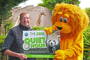 Zoo manager Alyn Cairns and Brian the lion can't wait to welcome everyone to quiet hour at Belfast Zoo.