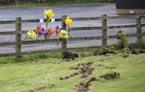 Flowers left at the scene for Lesley-Ann McCarragher aged 19, who died after a hit and run in Armagh on Saturday. Pic Pacemaker